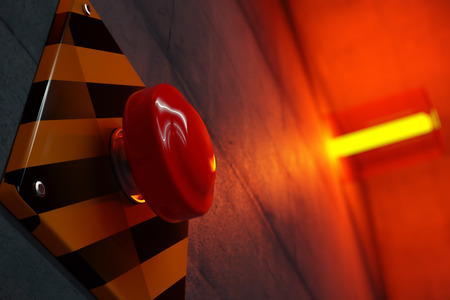 Close up of big red button during emergency situation. Red emergency light flashing in background. Reklamní fotografie
