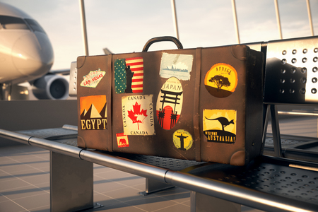 Suitcase With Worlds Famous Travel Destinations Labels At Airport Stock Photo
