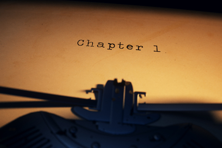 Chapter 1 Written On An Old Typewriter On Desk Stock Photo