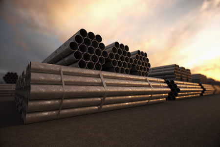 Stacked steel pipes, tubes used in the construction industry.