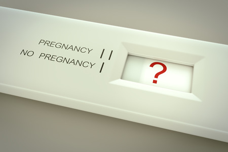 Pregnancy test in action. Question mark in result window.