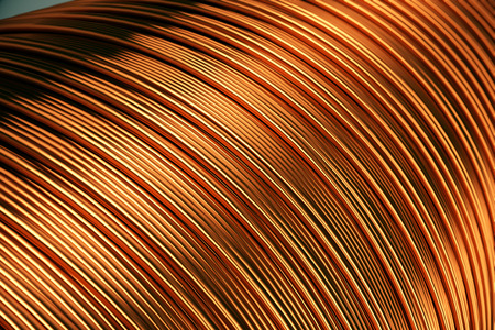 Close up of the bare bright copper wire on the spool.