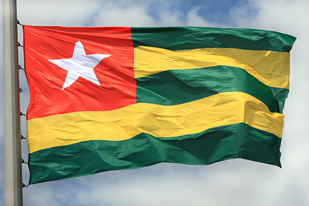 togo: Flag of Togo against the sky Stock Photo