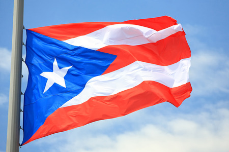 puerto rican flag: Flag of  Puerto Rico against the sky