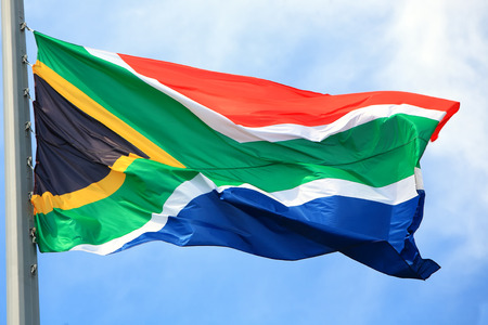 apartheid in south africa: Flag of the republic of South Africa against the sky
