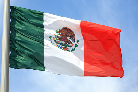 mexican flag: The Mexican flag against the blue sky Stock Photo