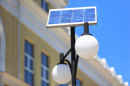 street lantern: Street lantern on the solar battery against a building Stock Photo