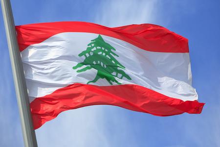 lebanese: The Lebanese flag against the blue sky