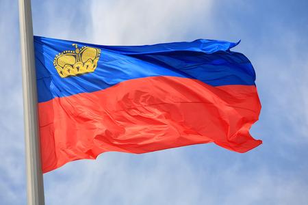 liechtenstein: Flag of Liechtenstein against the blue sky Stock Photo