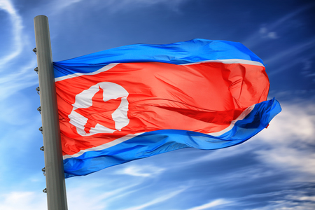 totalitarianism: Flag of North Korea against the blue sky