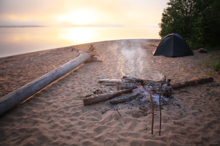 Beach Bonfire with  Sunset Sky Foto de archivo