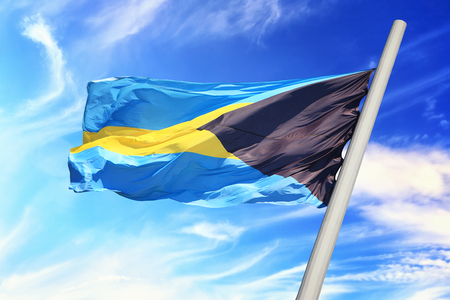 Flag of the Bahamas against the background of the blue sky Stock Photo