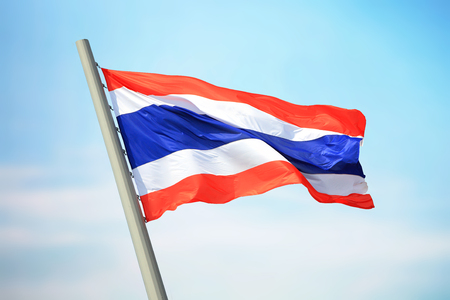 Flag of Thailand against the background of the sky