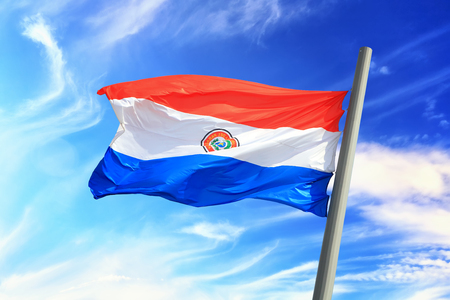 Flag of Paraguay against the background of the sky 免版税图像
