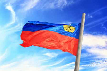 Flag of Liechtenstein against the background of the sky
