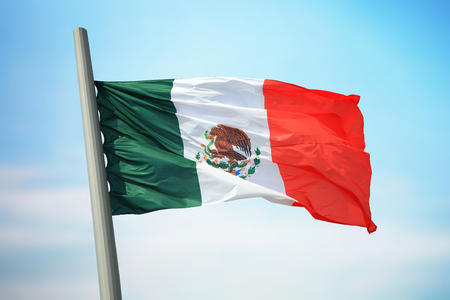 Flag of Mexico against the background of the sky
