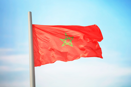 Flag of Morocco against the background of the sky
