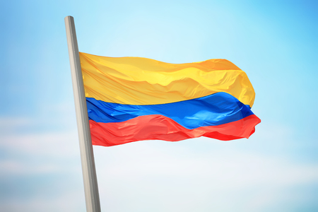 Flag of Colombia against the background of the sky 免版税图像