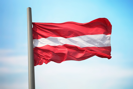 Flag of Latvia against the background of the sky