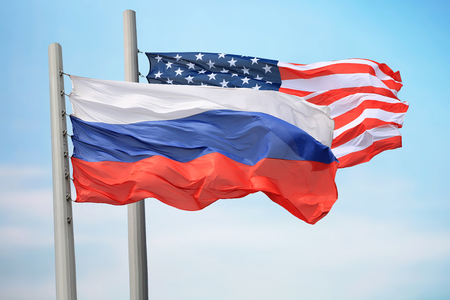 Flags of Russia and the USA against the background of the blue sky