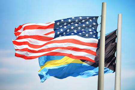 Flags of the USA and the Bahamas against the background of the blue sky