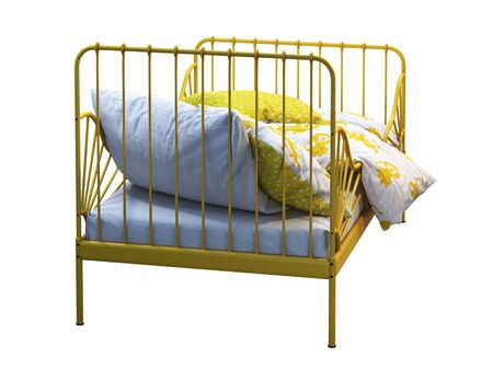 Yellow metal frame single children's bed with colorful linen on white background. Scandinavian interior. Bedding set