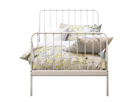 White metal frame single children's bed with colorful linen on white background. Scandinavian interior. Bedding set