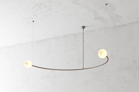 Modern bronze lamp. The loft-style. Turned lamp on the background of a concrete wall. 3d render