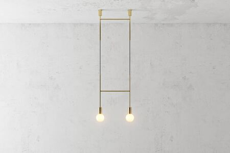 Modern gold metal lamp. The loft-style. Turned lamp on the background of a concrete wall. 3d render