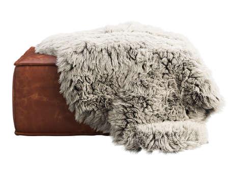Brown leather mid-century ottoman with pelt on white background. Modern, Loft, Scandinavian interior. 3d render