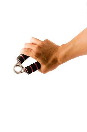 gripping: hand gripping exercise tool isolated