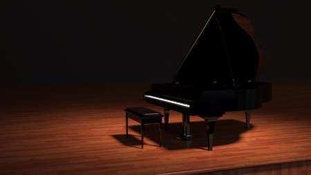 A spotlight shines on a piano centre stage  photo
