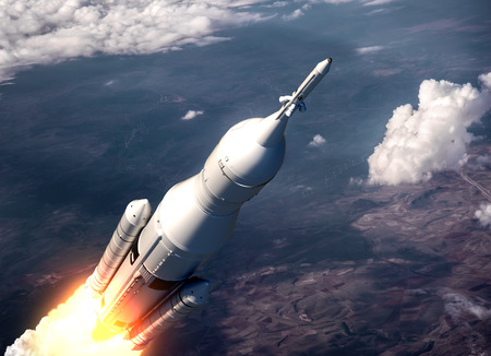 orbital spacecraft: Space Launch System Flying Over The Clouds. 3D Scene. Stock Photo