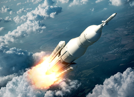launching: Space Launch System Flying Over The Clouds. 3D Scene. Stock Photo