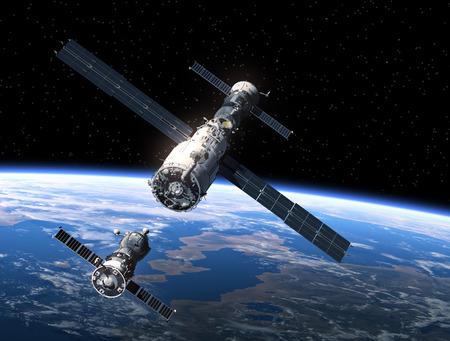 orbital spacecraft: Spacecraft And Space Station Orbiting Earth. 3D Scene. Stock Photo