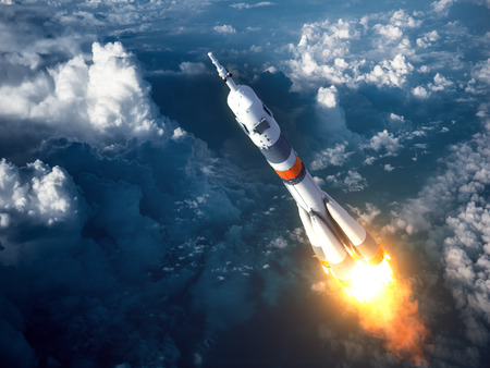 blast off: Carrier Rocket Launch In The Clouds. 3D Scene. Stock Photo