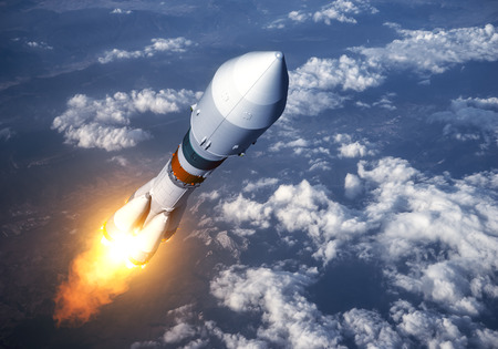 blast off: Cargo Carrier Rocket Launch In The Clouds. 3D Scene. Stock Photo