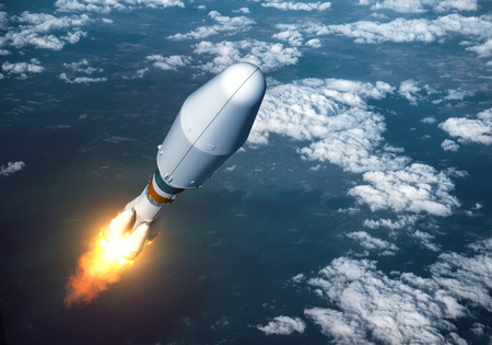 satellite launch: Heavy Carrier Rocket Launch In The Clouds. 3D Illustration. Stock Photo