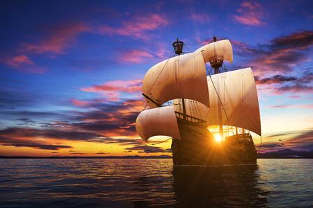 historic: Caravel On The Sunset Background. 3D Illustration. Stock Photo