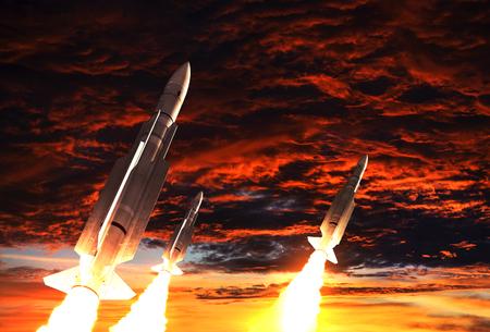 Tres cohetes despega en el fondo del cielo apocalíptico Foto de archivo