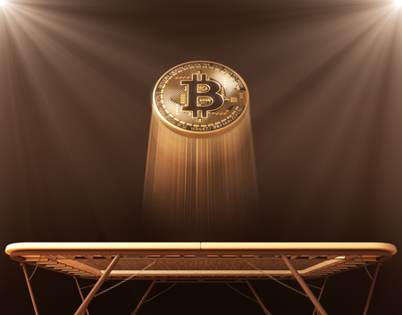 Golden Bitcoin Jumps On The Trampoline Stock Photo