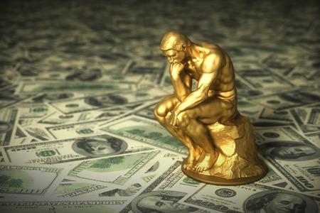 Penseur de sculpture en or sur des dollars américains verts
