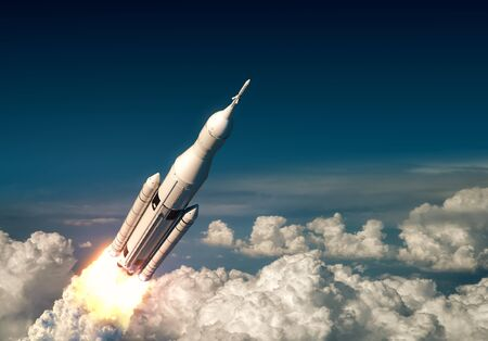 Flight Of Big Carrier Rocket Above The Clouds Stock Photo
