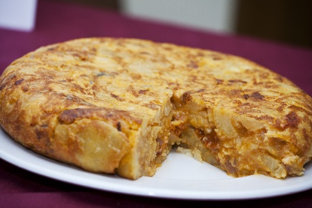 Spanish omelette with chorizo   and peppers photo