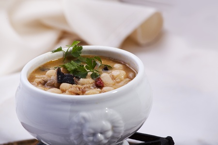 stew pot: delicious dish of beans cooked with mushrooms and quail