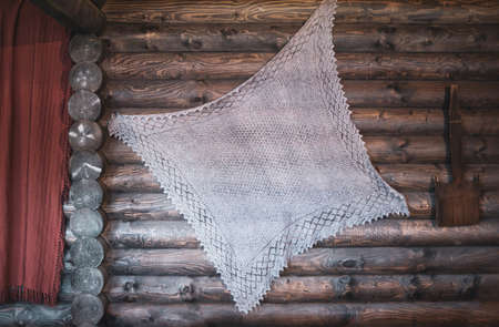 traditional crocheted napkin hanging in a wooden hut at a 17th century thematic historical festival in Moscow, Russia