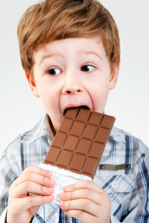 provocative food: Close Up of Young Boy Eating A chocolate bar