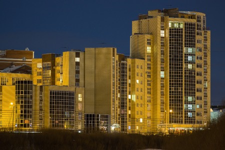multi-storey building on the waterfront at night