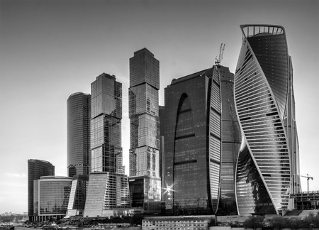 international business center: Moscow-city at evening Moscow International Business Center against the backdrop of the sunset sky in black and white