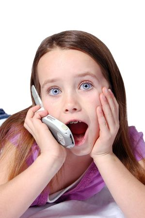 A nine year old girl talking on a cell phone. photo